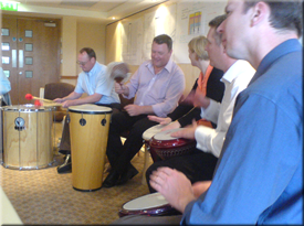 Building rapport between staff through Active Rhythmology drumming activities.