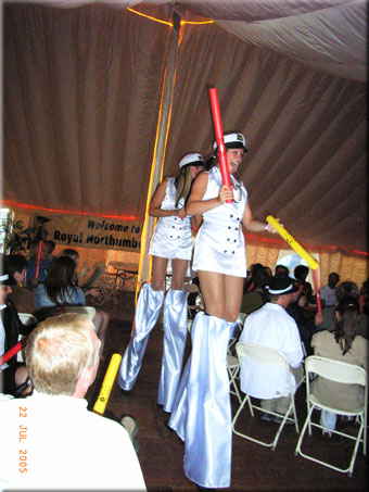 Two stilt dancers join in the Boomwhacker rhythmical excitement.